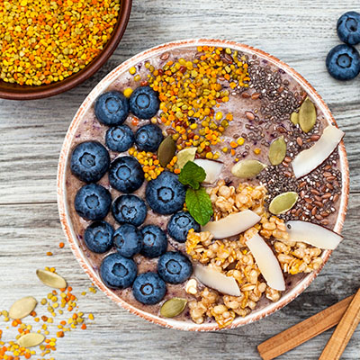 Acai breakfast superfoods smoothies bowl with chia seeds, bee pollen