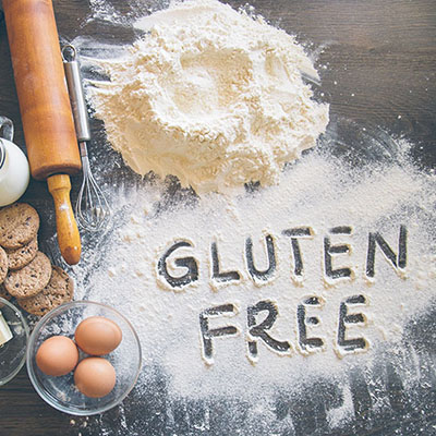 "Baking background with ""Gluten free"" writting in flour"