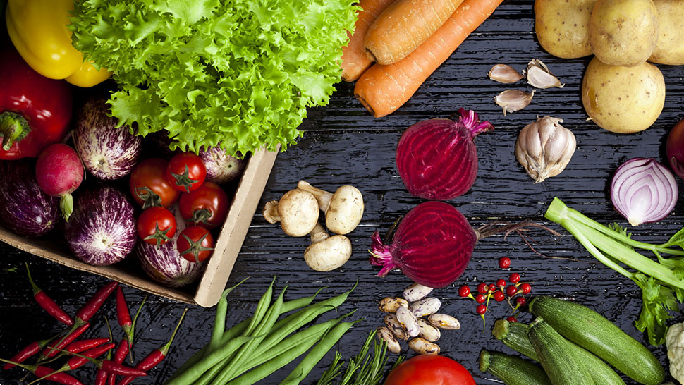 Top view of fresh vegetables on dark background