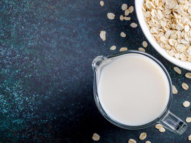 Oat milk on a dark table