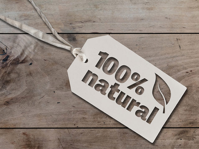 white hang tag cardboard lable with string attached an text 100 percent natural on rustic wooden table