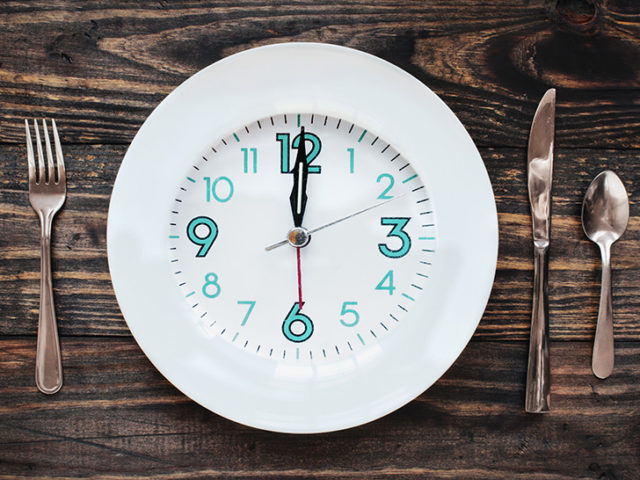 Twelve hour intermittent fasting time concept with clock on plate